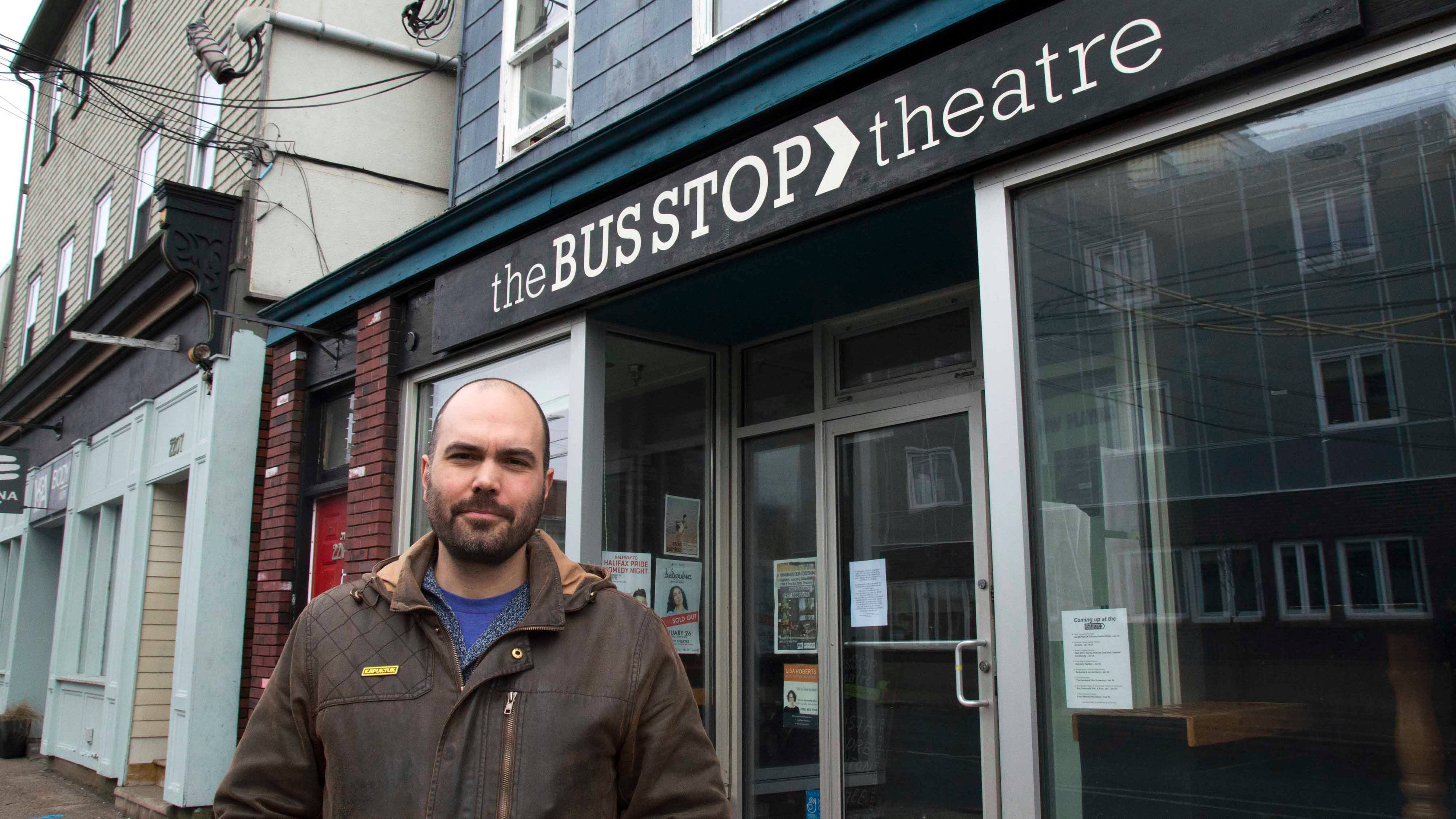 The Bus Stop Theatre's executive director, Sébastien Labelle, stands outside the front doors.
