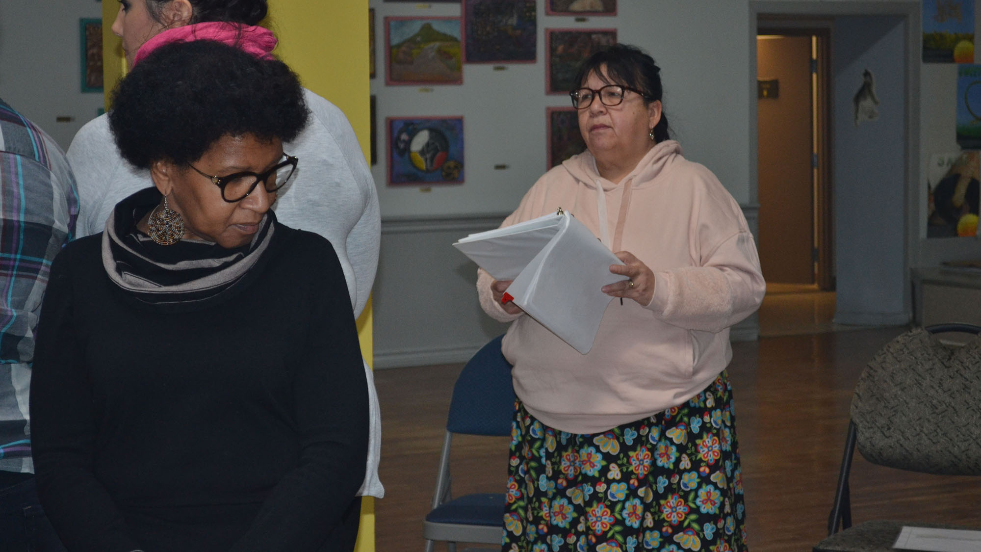 Debbie Eisan (right) leads a blanket exercise at the Mi'kmaw Native Friendship Centre.