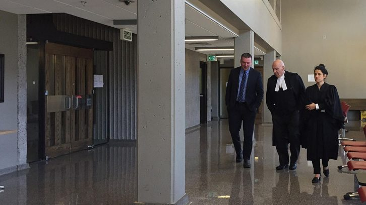 Craig Robert Burnett, left, walks back into Nova Scotia Supreme Court with his legal counsel on Jan 29.