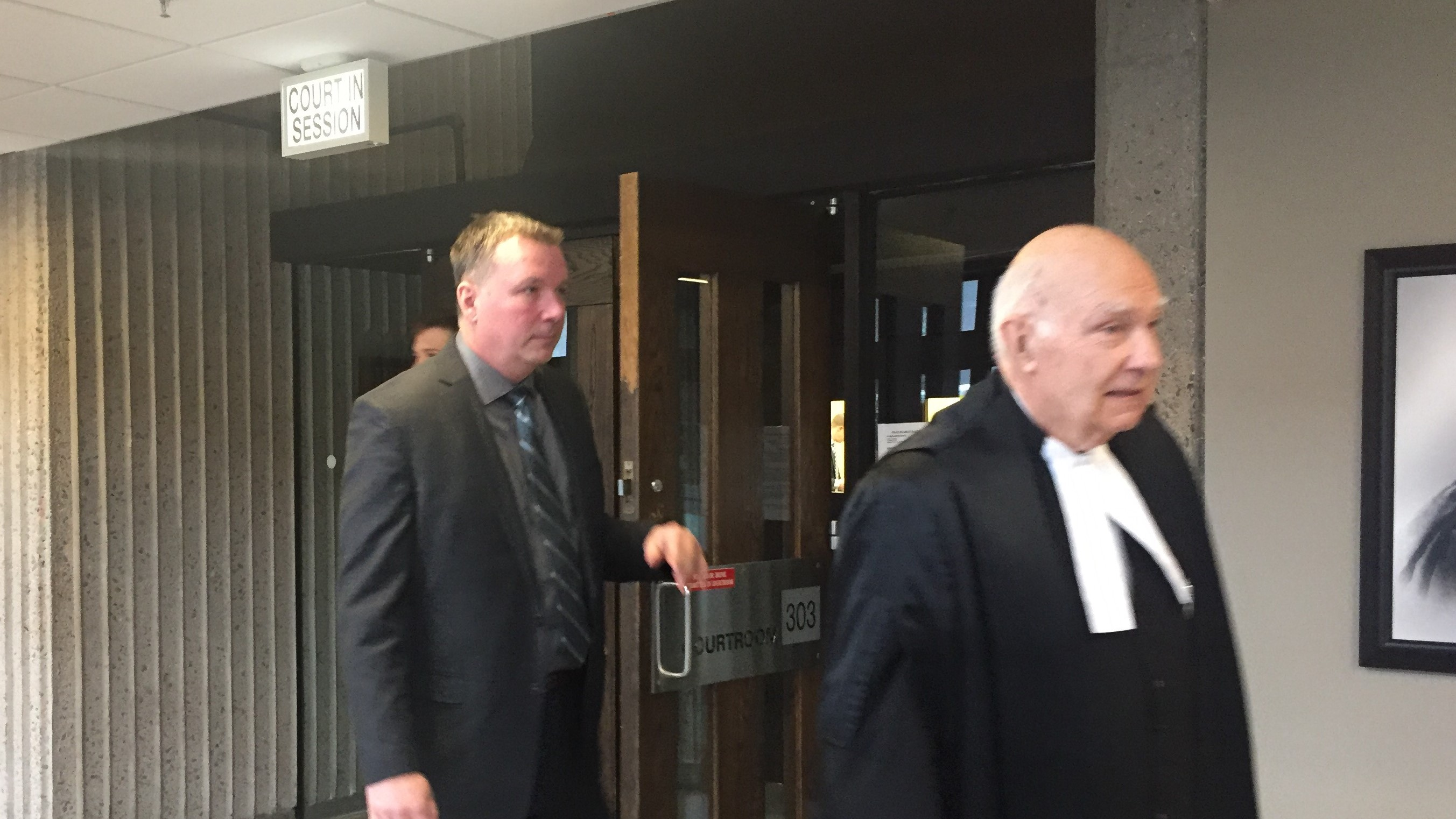 Craig Robert Burnett (left) leaving court room on the fourth day of his trial.