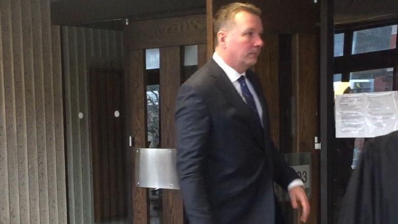 Craig Robert Burnett leaving the courtroom on Wednesday.