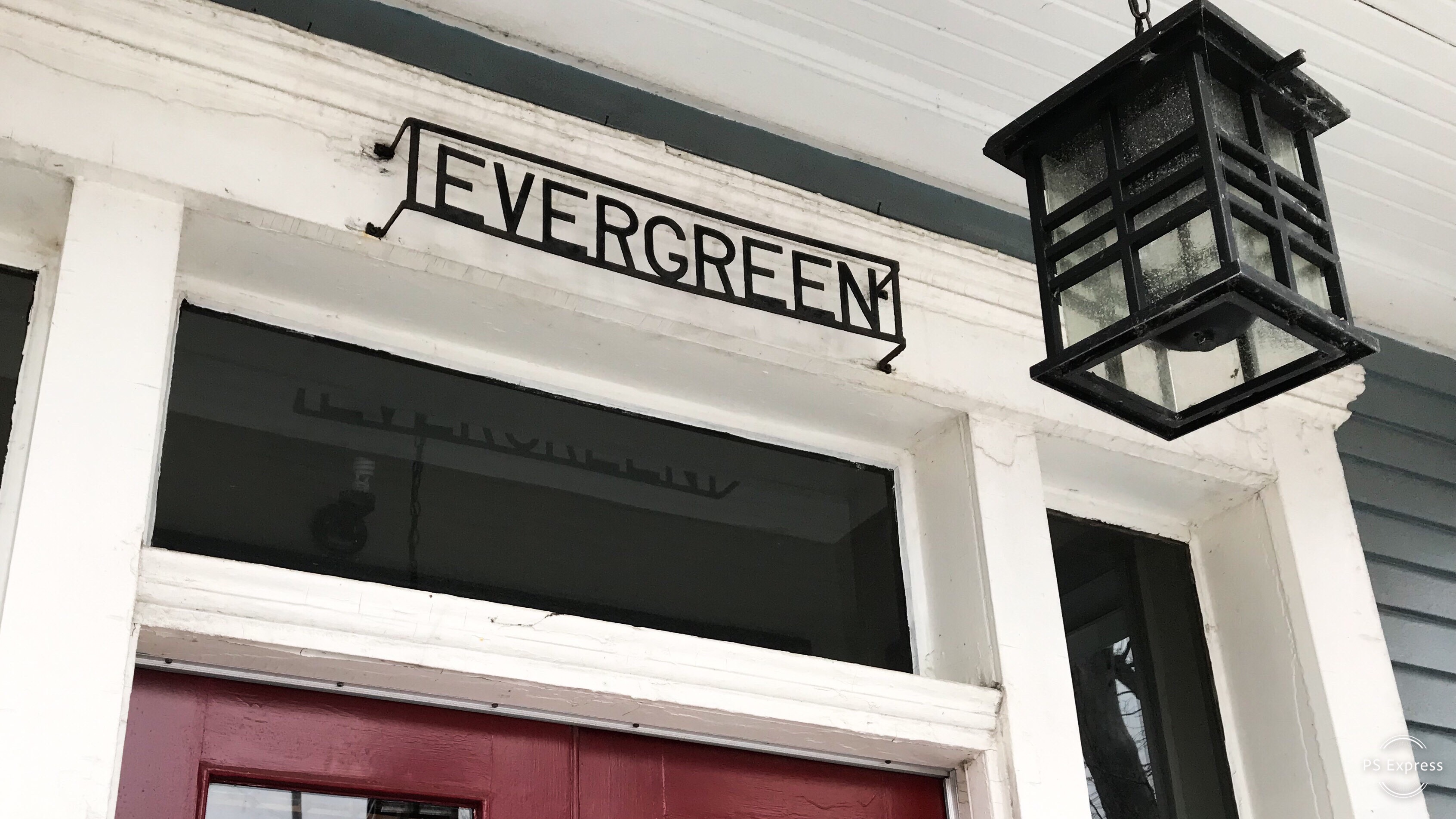 An outside door archway with the house name, Evergreen.