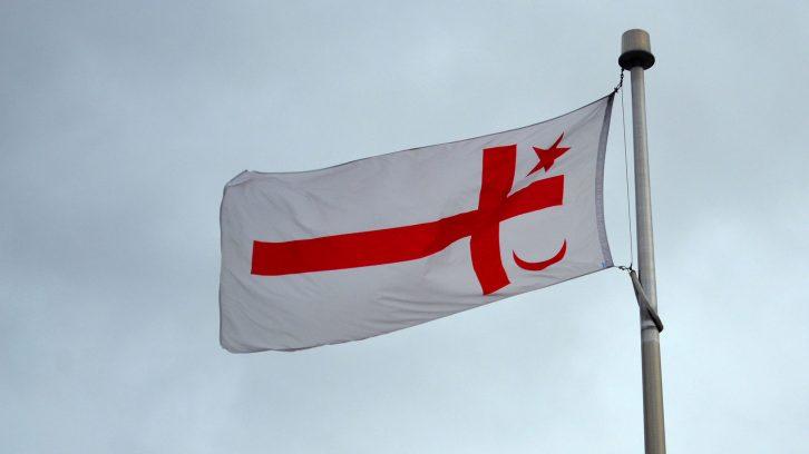 A Mi'kmaq flag flies over unceded and unsurrendered Mi'kmaq territory.