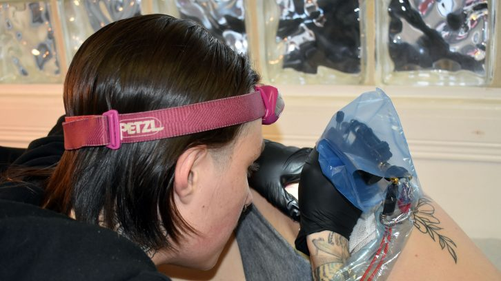 Gabe David works on a tattoo for a client at Outlaw Country Tattoo.