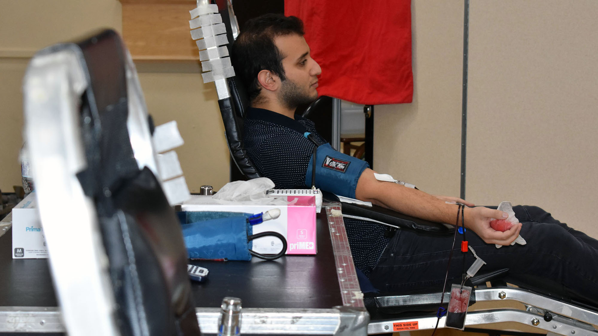 Ummah community member Hasan Sinan feels good after giving blood.