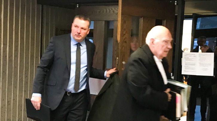 Craig Robert Burnett (left) and lawyer David J. Bright  leave the courtroom Monday.