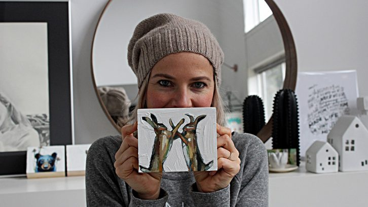 Melissa Townsend holds a piece featured in Pre-Shrunk 2019.
