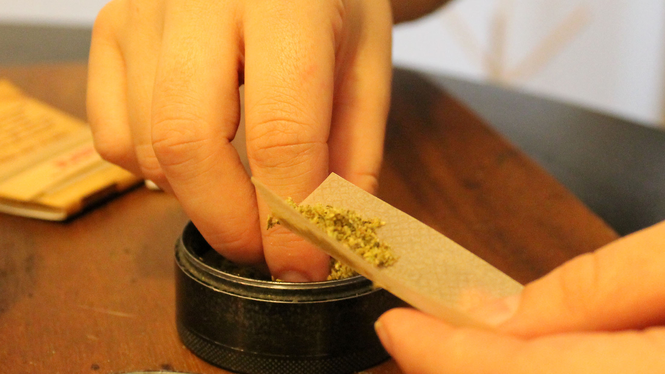 A cannabis user rolls a joint in her Halifax apartment.