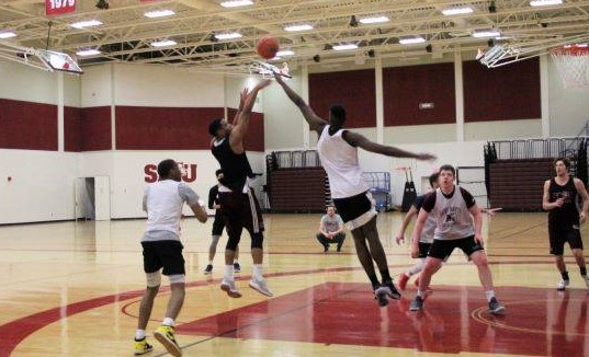 Co-captain of the Huskies Kemar Alleyne shoots a jump shot during practice.