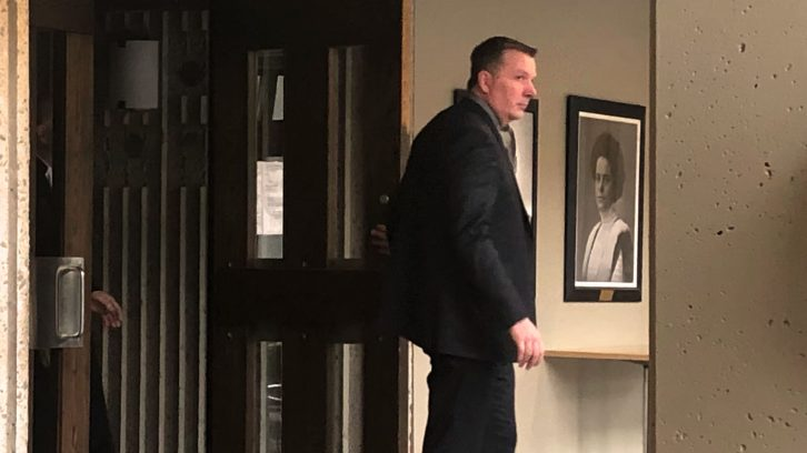 Former RCMP officer Craig Robert Burnett leaves his trial on Feb. 4.