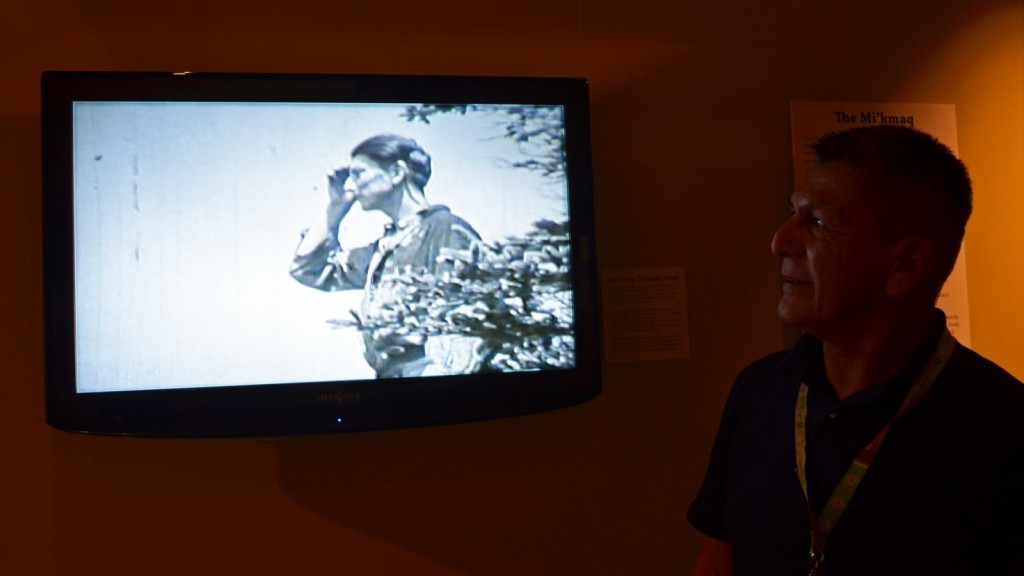 Roger Lewis watches his grandfather in a film on exhibit in the Nova Scotia Museum of Natural History. For Lewis, the history of his people, the Mi'kmaq, is part of his life every day.