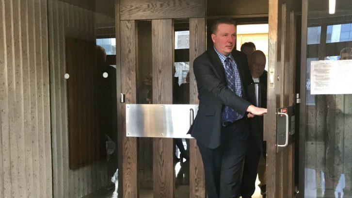 Former ex-Mountie, Craig Robert Burnett, exits the courtroom on Wednesday.