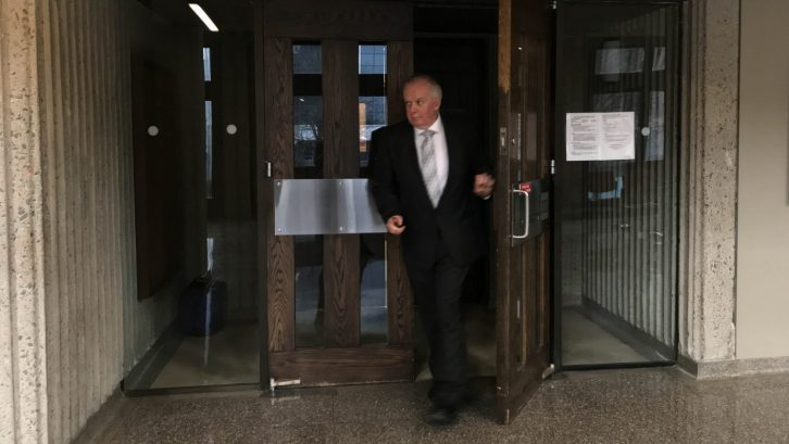 Crown's latest witness, civilian RCMP employee Shaun MacEachern, leaves the courtroom after testifying on Thursday Feb. 7 in the drug trial against ex-Mountie Craig Robert Burnett.