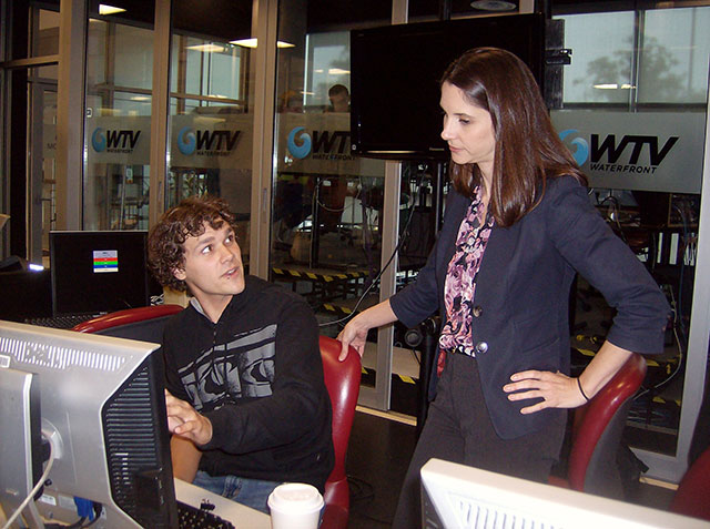 Broadcast journalism instructor Erin Moore helps a student in the NSCC studio in Halifax, Nova Scotia.