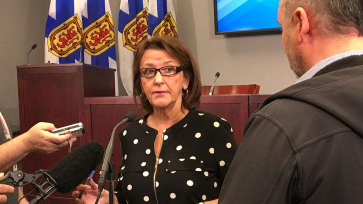 Nova Scotia Finance Minister Karen Casey responds to reporters Thursday morning.