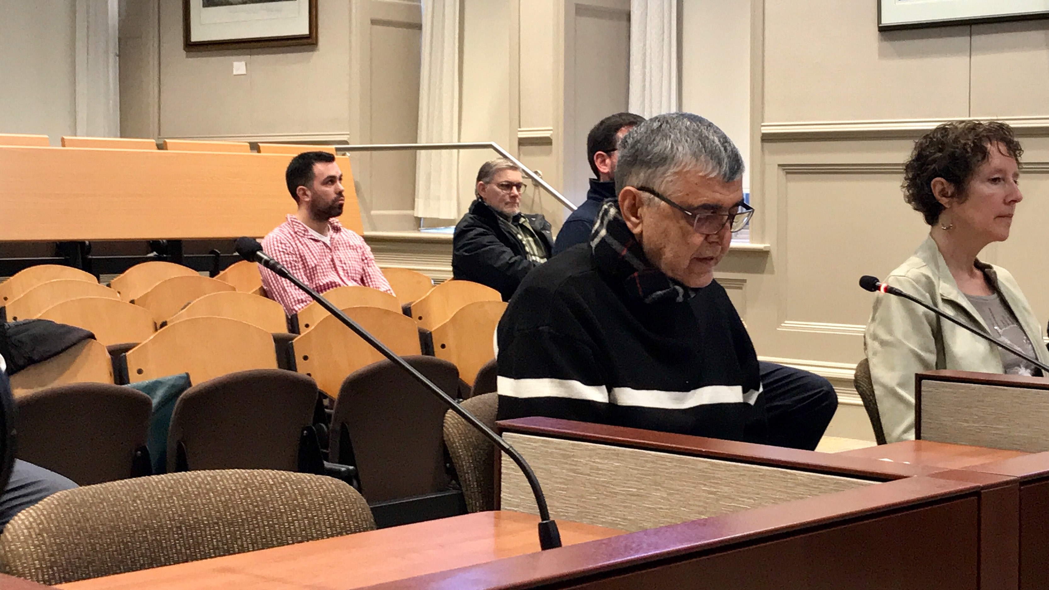 Seyed Lavasani, 74, reads a letter to the appeals committee on Feb. 14, regarding his taxi driver license suspension.