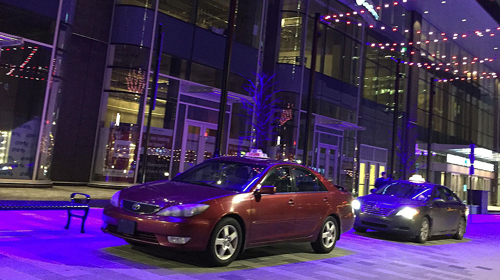 Two taxis waiting outside of the Halifax Convention Centre.