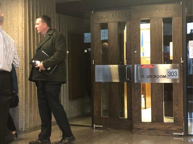 Ex-RCMP officer Craig Robert Burnett leaves court on Feb. 5.