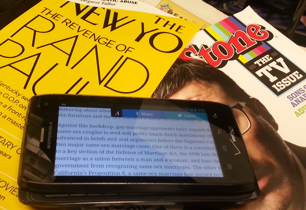 Two types of magazines: the scroll-able smartphone on top of traditional print.