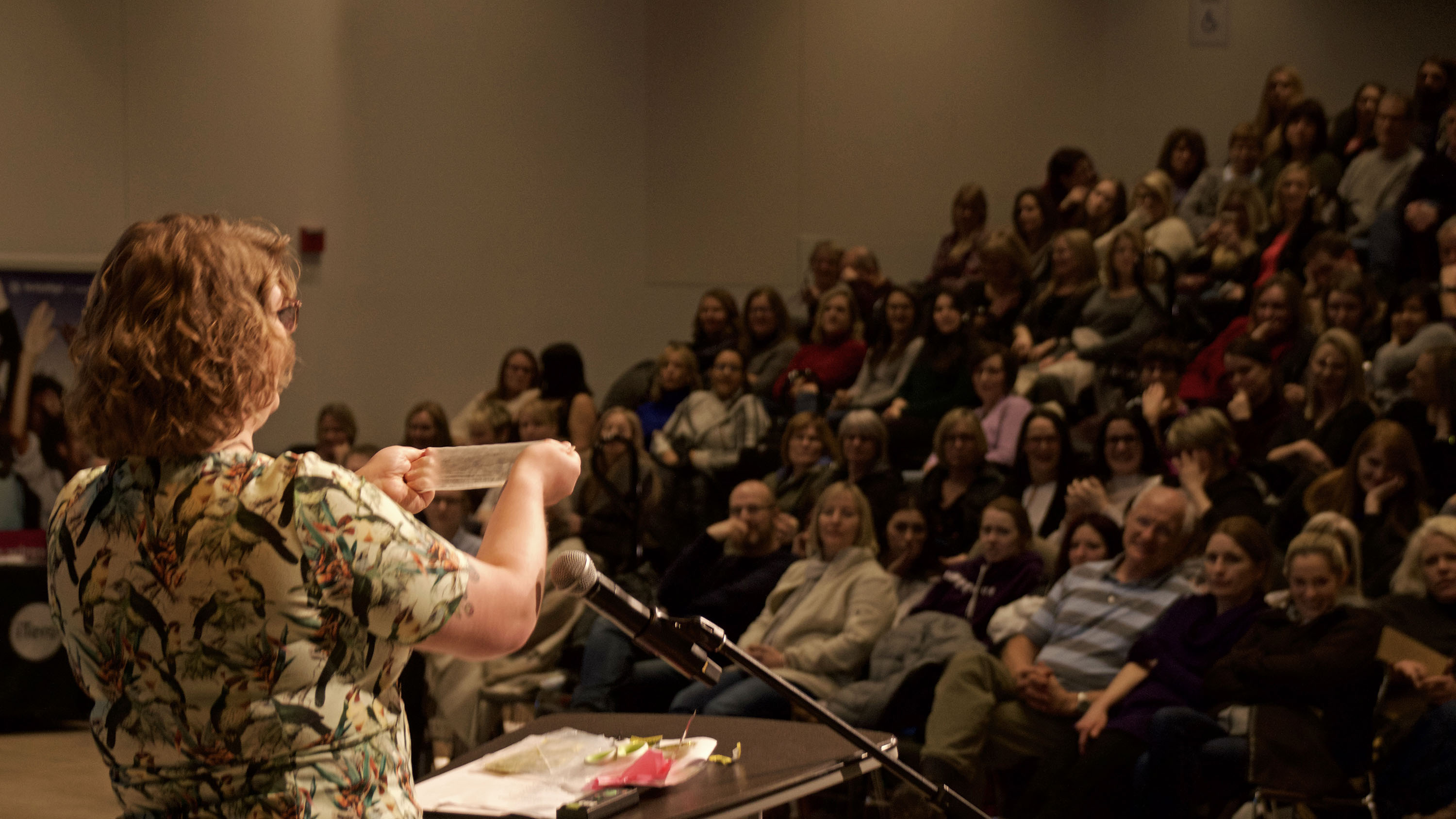 Abbey Ferguson of the Halifax Sexual Health Clinic holds up a dental dam to a giggling crowd of dental professionals.