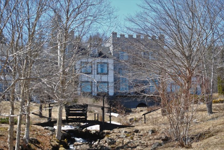 Castle Gracie is seen through trees in mid-April,2019