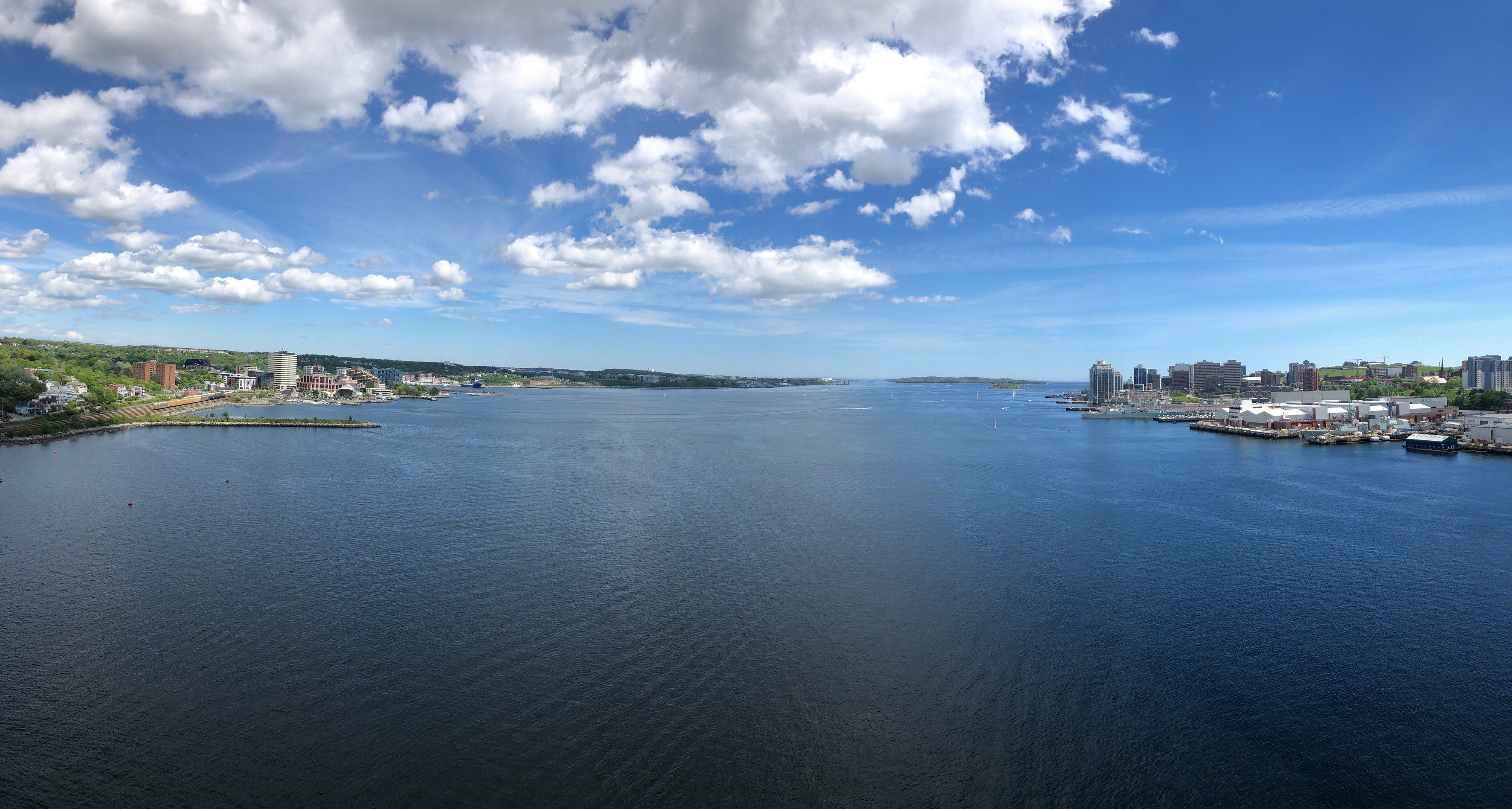A panoramic view towards the mouth of the Halifax Harbour, spanning the Dartmouth waterfront to the Halifax waterfront, from the centre of the A. Murray MacKay Bridge.