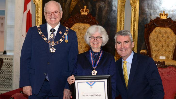 Dr. Noni MacDonald receiving her award alongside Lt.-Gov. Arthur J. LeBlanc and Premier Stephen McNeil.