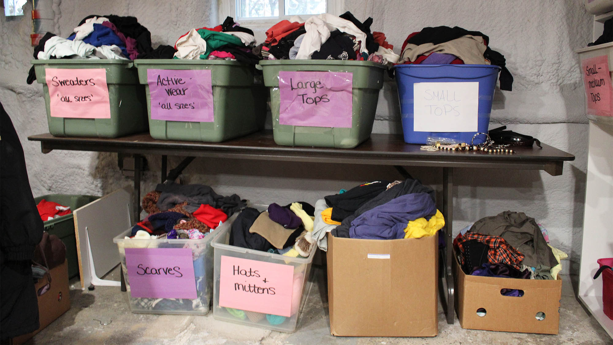 Clothing bins in the Elizabeth Fry Society's clothing room.