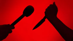 A person with a knife is seen with a person holding a microphone