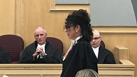 Lawyer Rebecca Hiltz LeBlanc giving a speech to begin the ceremony