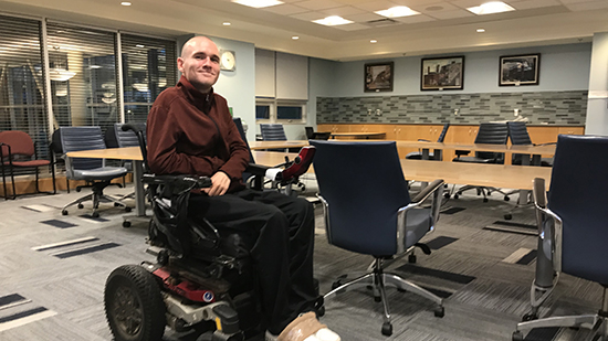 Alex LeBlanc posing in an NSCC classroom.