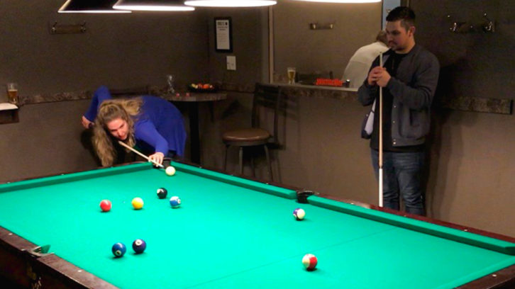 Jean-eva Dickie and Winston Guitar play pool during a speed friending event last Tuesday.