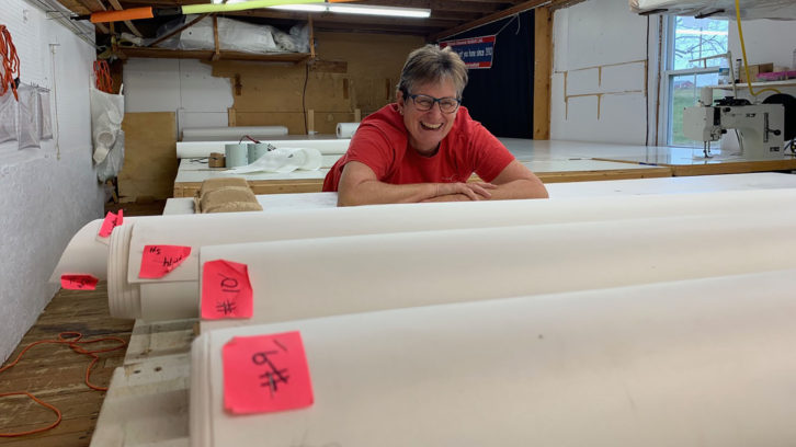 Michele Stevens behind the 16 panels that will be used to create the Bluenose II's mainsail.
