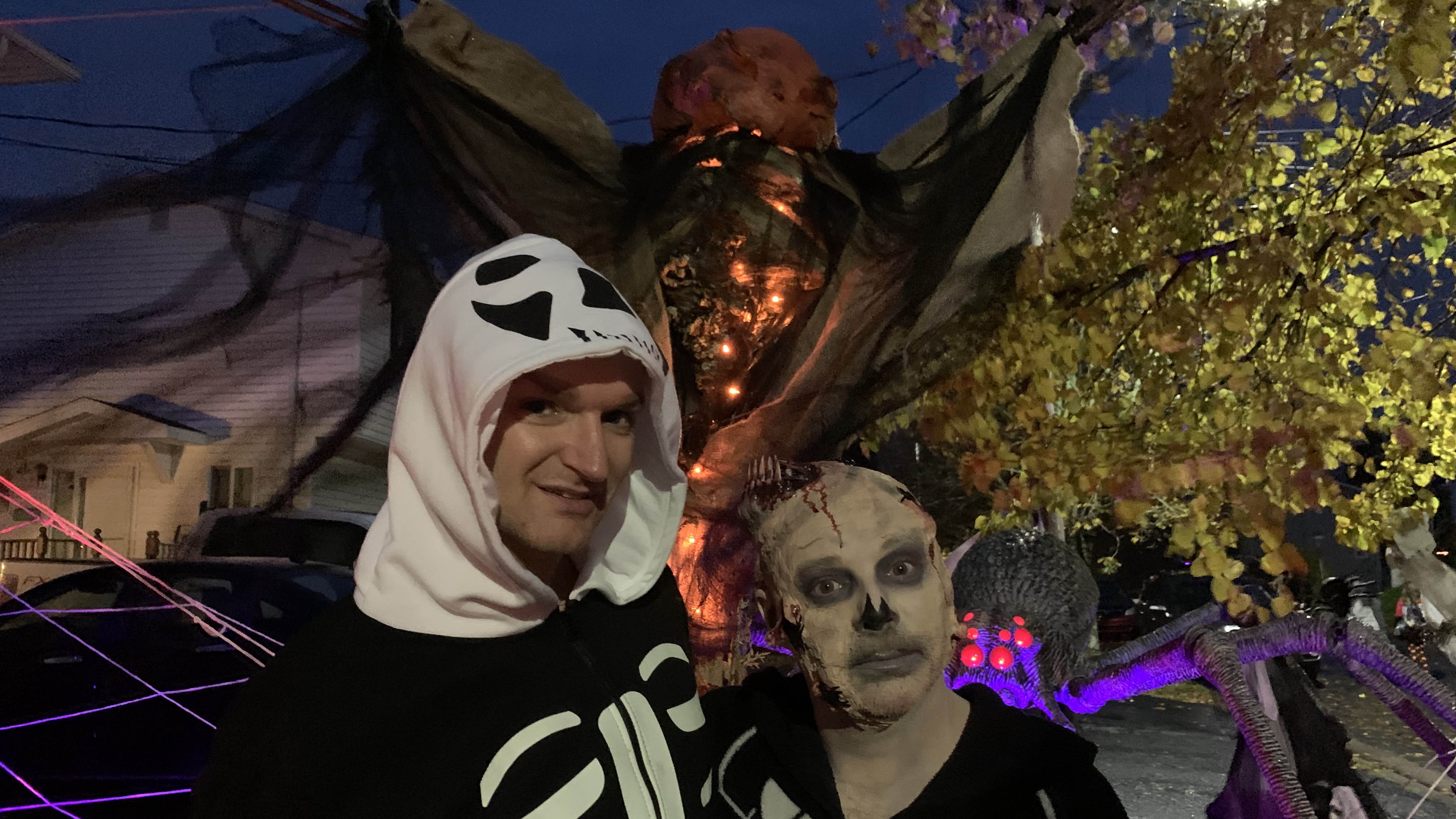 Steven MacLeod and Jacob Rafuse pose for a photo in front of their Halloween decorations.