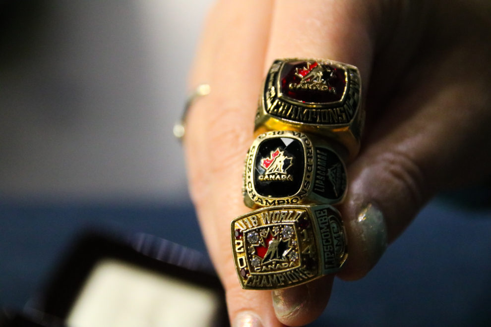 Lipscombe shows off the rings she won during various World Championships while working with Hockey Canada.