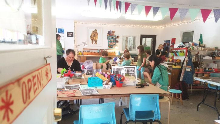 Students and community members making art in a Wonder'neath session