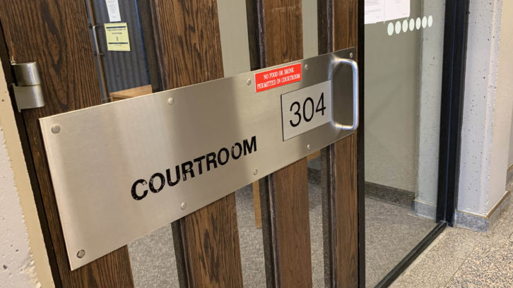 The sign on the courtroom's door, Dec. 3.