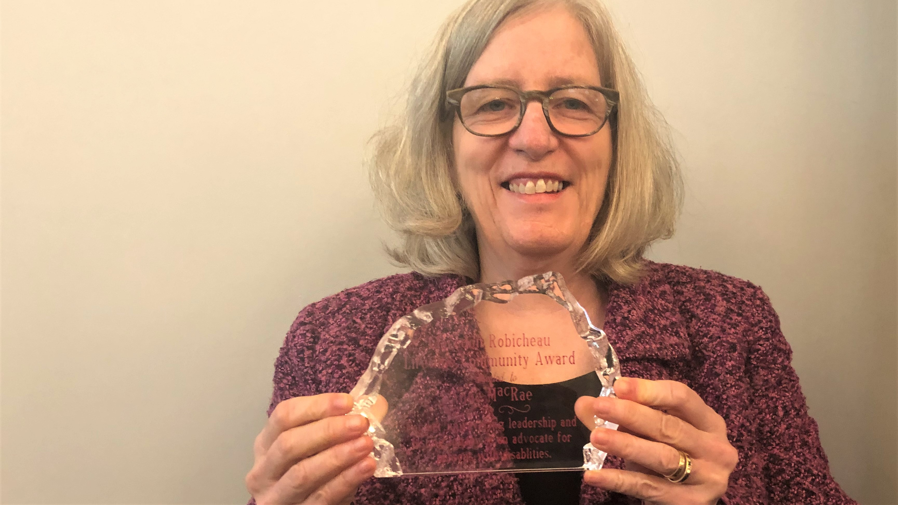 Anne MacRae poses with her award.