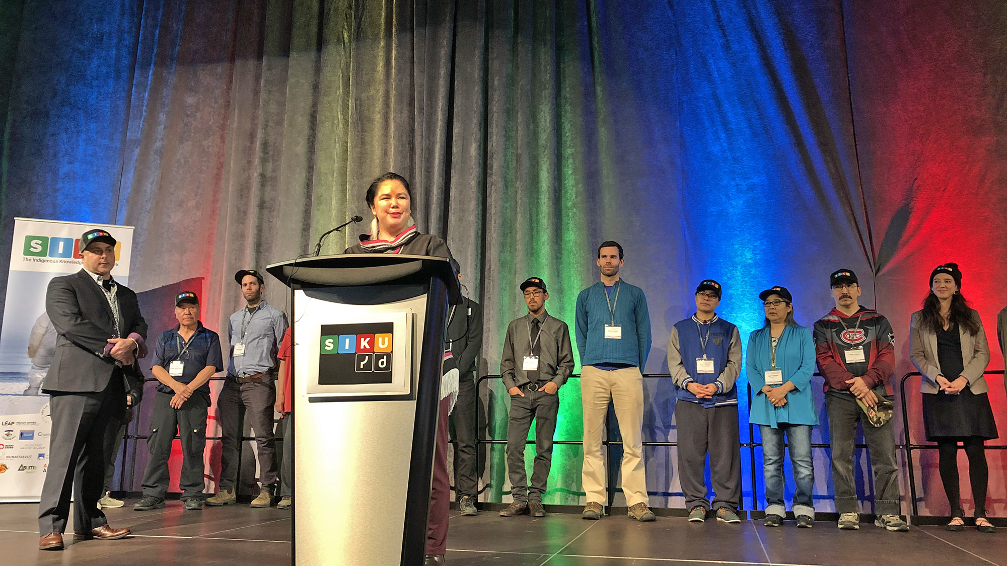 Candice Pedersen, SIKU team member, is joined by the rest of the SIKU team on stage at the Halifax Convention Centre.