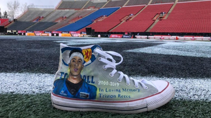 A portrait of Triston Reece was painted on a pair of Converse shoes by Kemmy Smith to be worn at the Grey Cup by Matthew Scianitti.