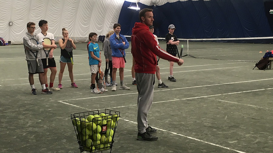 Gareth Dowdell instructs a group of junior players at the Atlantic Tennis Centre in Bedford Commons. The centre is set to expand in the spring from the original courts pictured here.