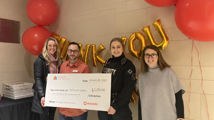 From Left: Carrie-Anne Turner, Andrew Ward awarded a cheque to Lauren Vatcher and Stephanie Schnare to continue the work they are doing at The Centre.