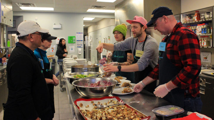 Food access coordinator George Shannon (second from right), leads a team of volunteers who help prepare community meals three days a week at the Dartmouth North Community Food Centre.