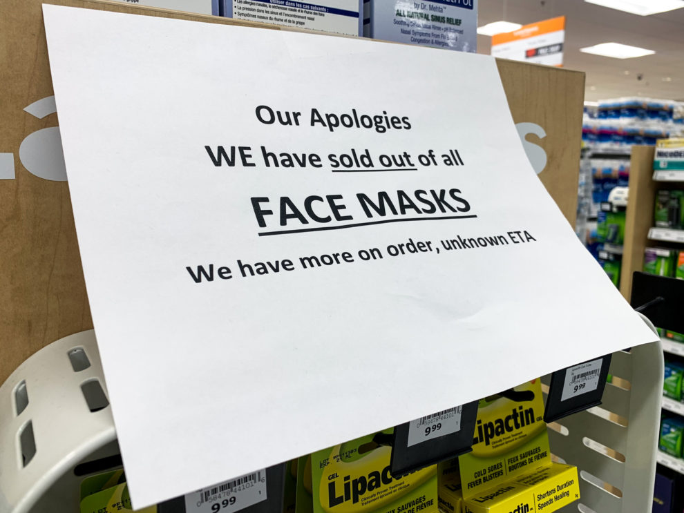 A sign saying a Lawton's is sold out of all face masks.