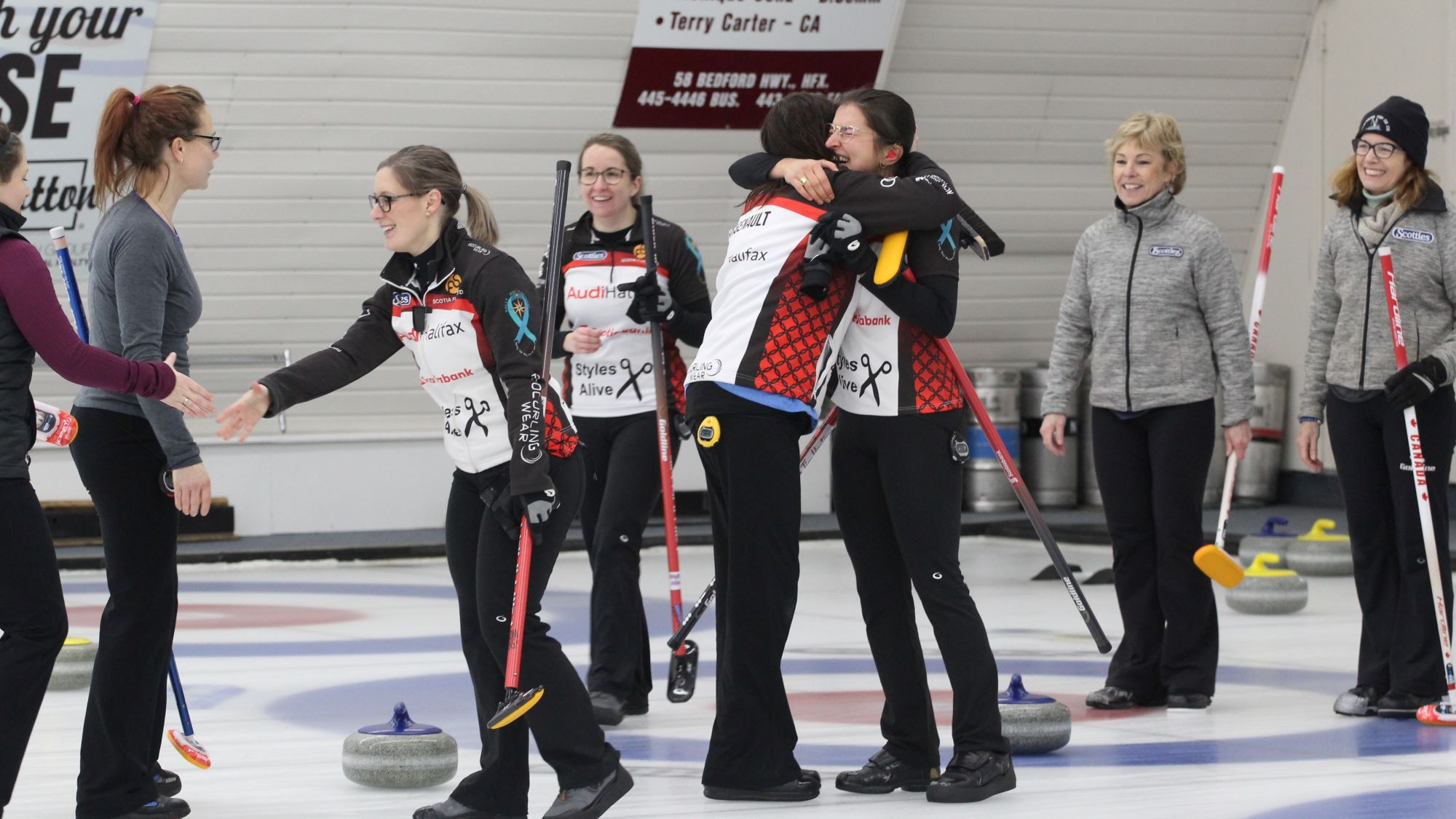 Mary-Anne Arsenault and Emma Logan embrace as their team wins the 2020 Nova Scotia Scotties Tournament of Hearts.