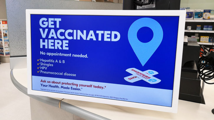 A sign advertising vaccines at a Shoppers Drug Market in Halifax.