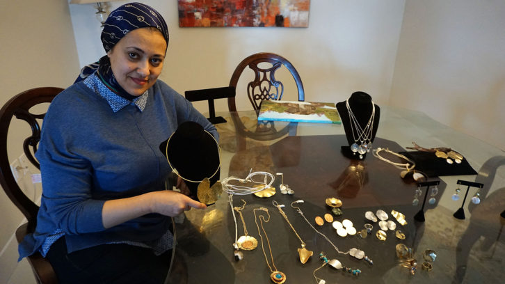 Amal Ragab shows off some of her jewelry that will be on display at the market on Saturday.