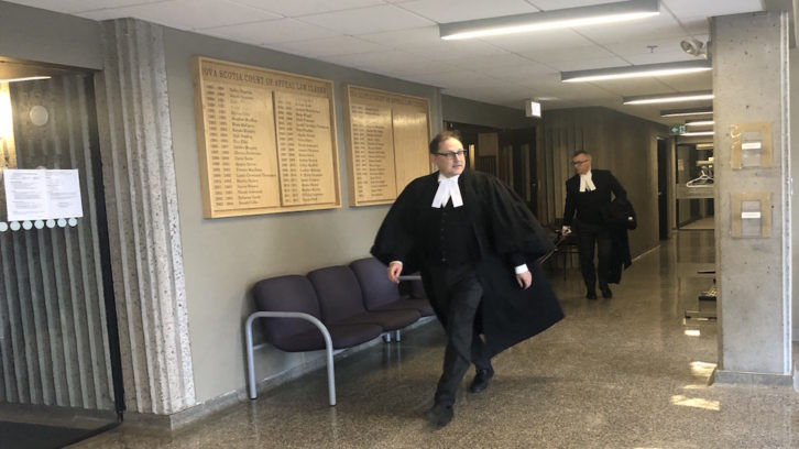 Defence lawyer Ian R. Smith leaves the courtroom Tuesday.