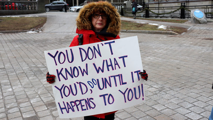 Cindy Moxsom demonstrated at Tuesday's rally about roadside memorials in HRM.