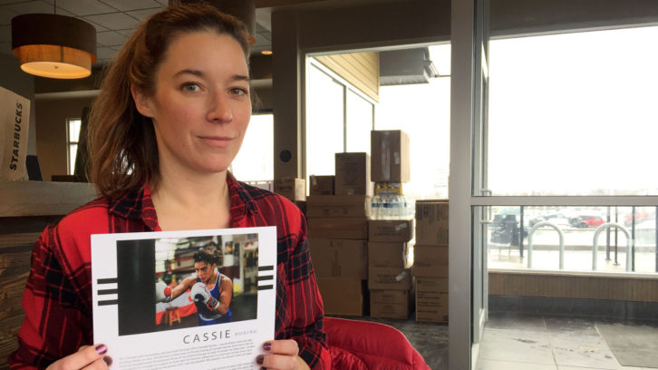 Lyndsay Doyle, 40, sits in sits in Starbucks, holding a page of her upcoming book.